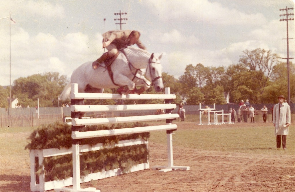 Harry loved to delight the audience by not holding the reins when they jumped. Photo from the Private Collection of Harry de Leyer