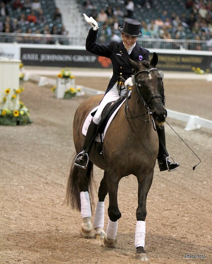 Jeanette celebrates with Valiant after their musical freestyle performance at the 2013 World Dressage Masters in Wellington, Florida. Photo by Alan Fabricant