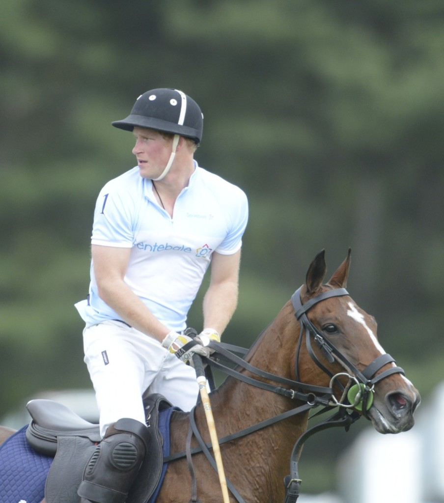 Prince Harry competing at the Sentebale Royal Salute Polo Club in Greenwich, Connecticut. Photo by John Robben