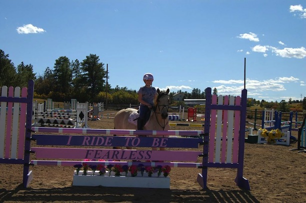 "The ""I Ride To Be Fearless"" jump was built as a surprise for Avery by donations from her barn family. Avery loved Taylor Swift and Taylor's song Fearless. The ""I Ride To Be Fearless"" phrase became the inspiration in honor of Avery's fight. Photo by Rochelle Costanza"
