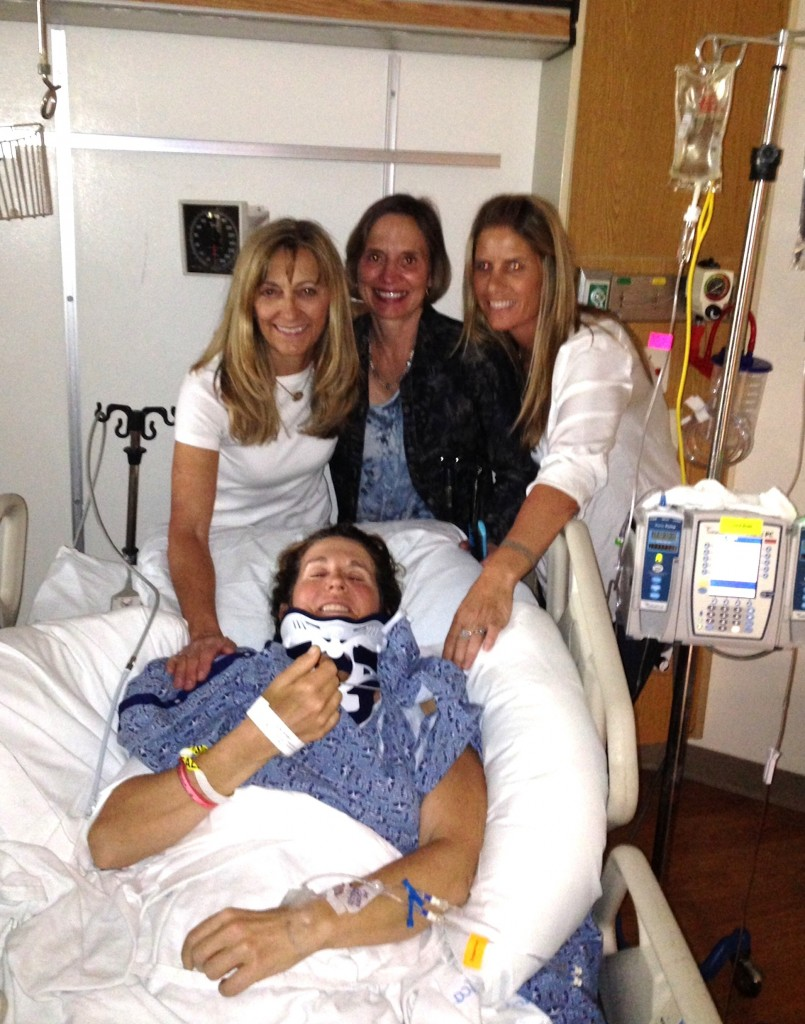 In ICU after the surgery that stabilized her fractured neck, Devon poses with great friends and clients Vicki Shinn, Linda Swanson and Lyn Ferrera. Devon admits that she still feels overwhelming gratitude for the support of friends, horsey and civilian alike, who even helped to feed her when her arms weren't working. Photo courtesy of friends