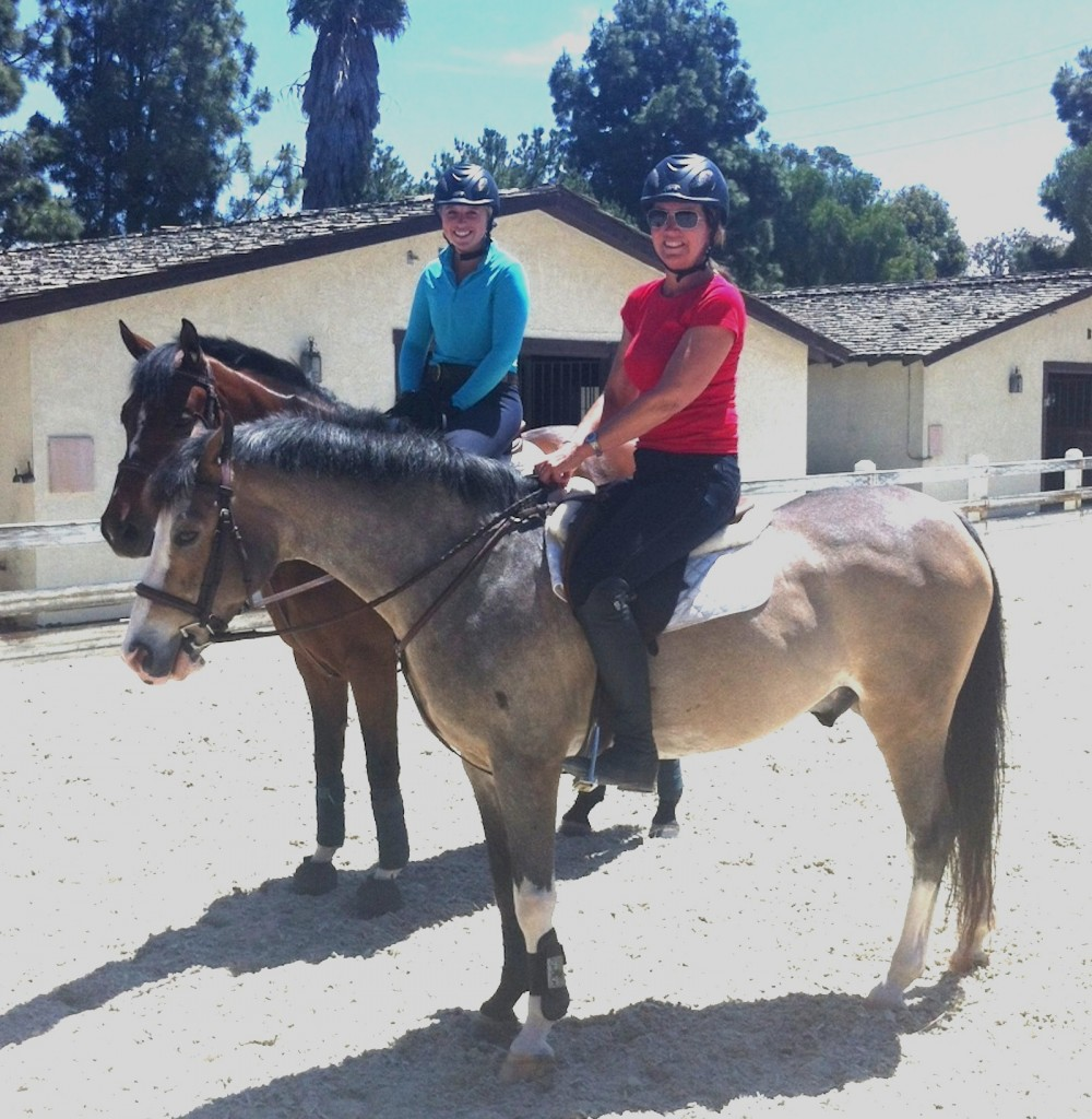 Devon's first ride took place only 12 weeks after the horrific fall that broke her neck and back, leaving her paralyzed from the neck down. She started driving and teaching again 10 weeks into recovery. Shown here, on this momentous occasion, aboard Popsicle, owned by Pam Griswold, with Kylee Arbuckle for company. Photo courtesy of Christy Arbuckle