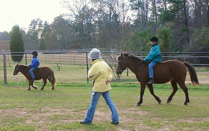 Jamie and Nicole in the early days, taking lessons on their ponies.