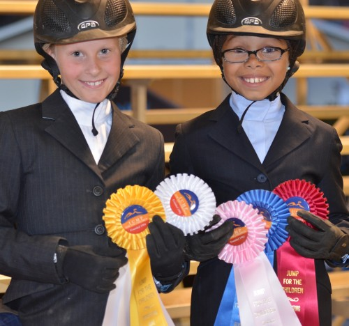 Young competitors show off their ribbons during the 2012 Jump for the Children Horse Show.