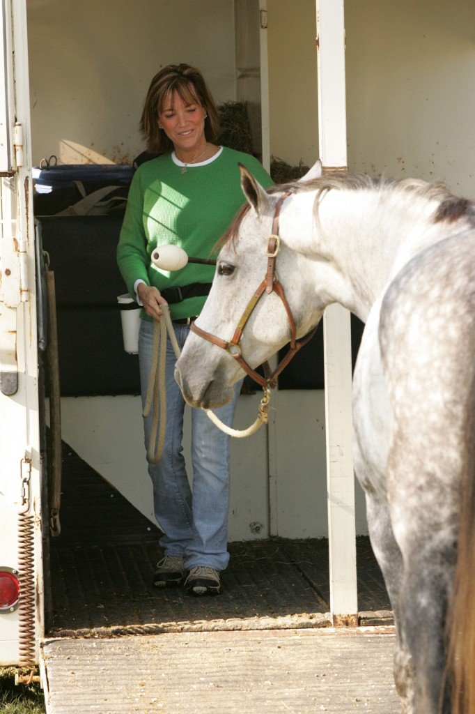 The goal of On Target Training is calm, happy, relaxed horses and people – using positive reinforcement. Shawna helps this horse to view a trailer as a good thing, not an object of fear, pain and worry, during a clinic in Southern Pines.  Photo by Bernard Schnake
