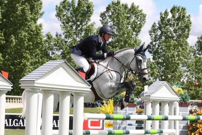 Quentin and HH Dark de la Hart competing at Spruce Meadows.  Photo by Cansport