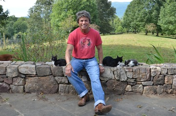 Rita Mae enjoys a few moments with some of her feline friends. In her newest novel, The Litter of the Law, Rita Mae collaborates with feline co-author Sneaky Pie Brown. Photo courtesy of Rita Mae Brown