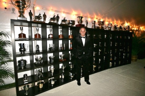 When Carlos was inducted into the Museum of Polo and Hall of Fame, the museum set up a display of his trophies in the marquee – a display that filled an entire wall. Photo by Alex Pacheco