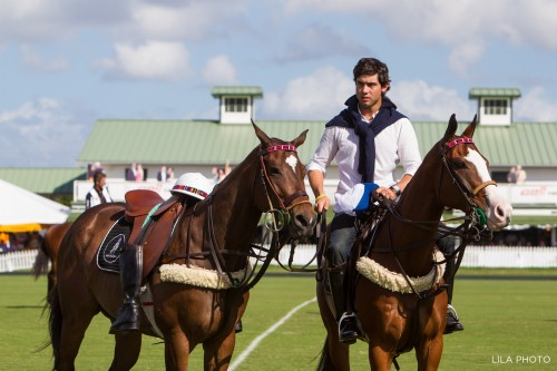 Carlos' son, Mariano, leads his dad's horse during a touching memorial ceremony at the International Polo Club, in Wellington, Florida. Photo by LILA PHOTO