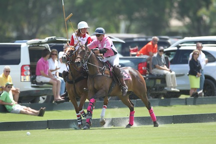 Kerstie rides off Facundo Obregon in the 26-goal handicap finals, Crab Orchard versus Coca-Cola. Photo by David Lominska, www.polographics.com