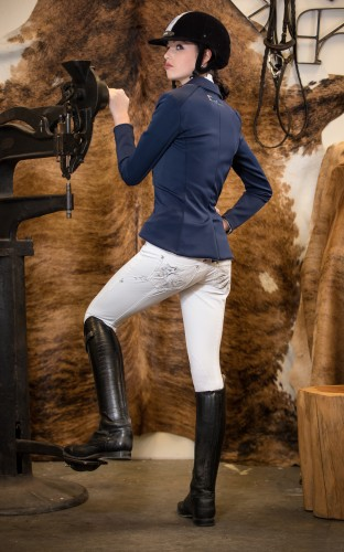 You have just found your new favorite show breeches. They're built from the perfect riding fabric — durable, stretchy, high-end white denim. 68% cotton, 29% Polyester and 3% Spandex to be exact. Which means they're very comfortable in the saddle and easy to care for. But it's their style that really sets them apart. Subtle front-pocket decoration gives way to an explosion of fun, fashionable embroidery and embellishment on the back of the white riding jean. You're sure to steal the show.
