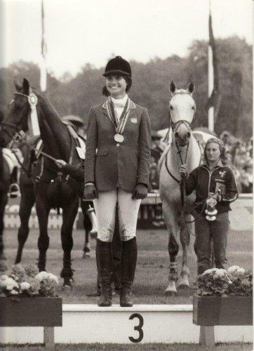 Kim on the podium at the Luhmuhlen World Championships in 1982. Kim's groom Lisa Fox is holding The Gray Goose in the background.  Photo by Hugo Czerny