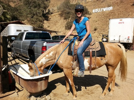 Giving my horse a drink before we head out. That's not the real Hollywood sign in the background, just a replica.