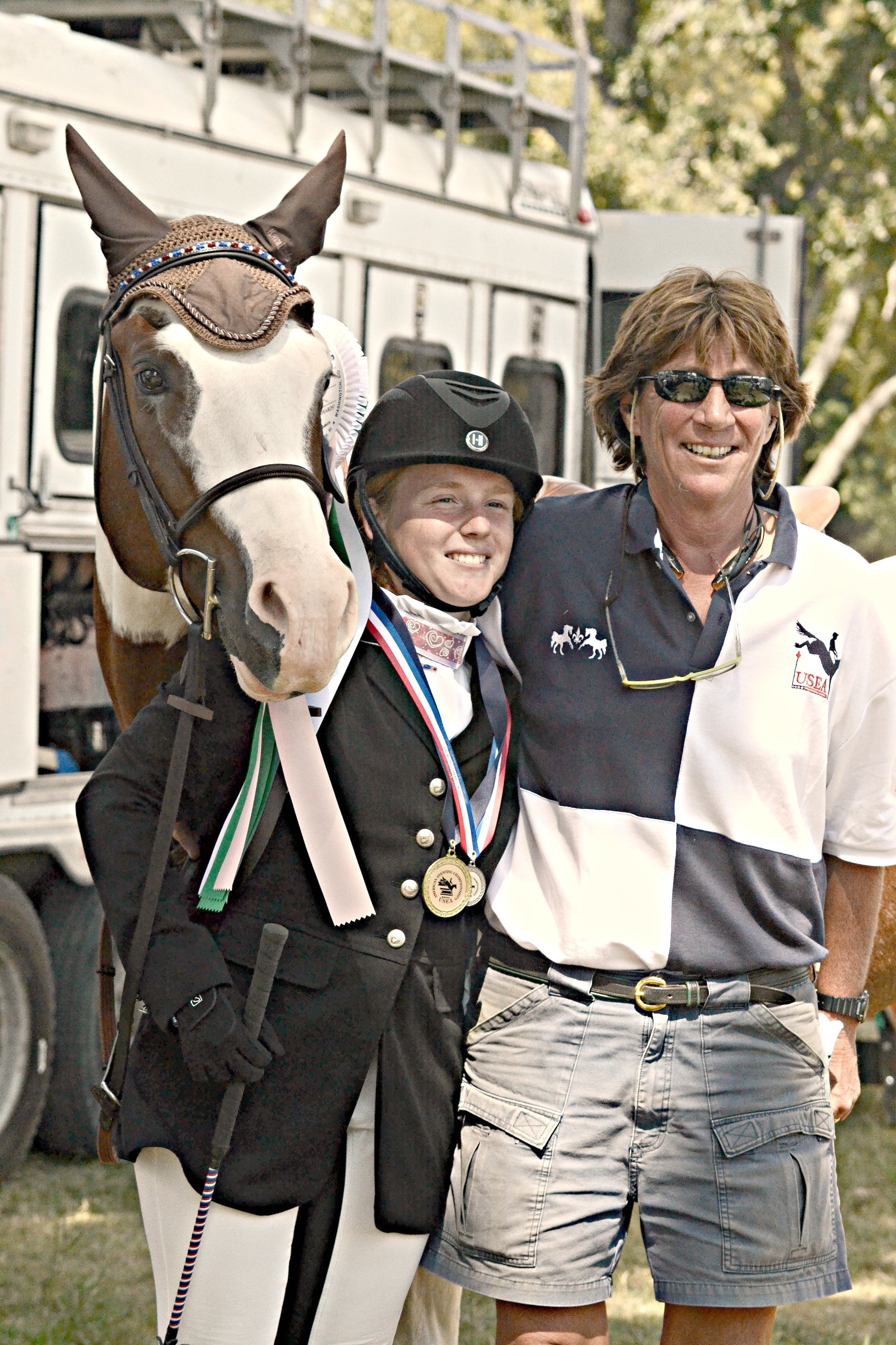 Cathy with student Bobbie Jones and Rebel's Heartbreaker, who earned fourth out of 31 starters in Novice Junior at the 2014 American Eventing Championships. (Photo by JJ Sillman Photography)