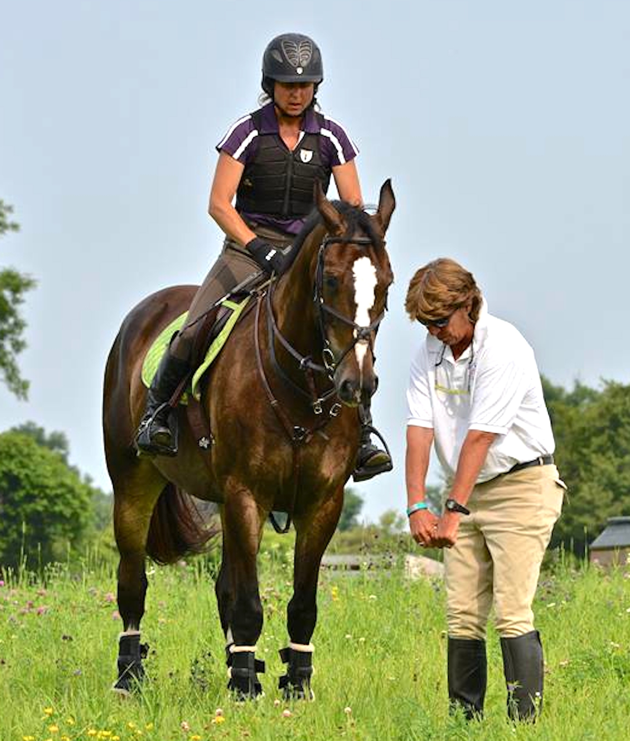 Cathy coaches Tamara Toro aboard Oliver Darby at the 2014 Sprucehaven Farm eventing clinic in Canada. (Photo by Ian Woodley)