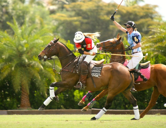 Pepsi and Kerstie — mallet in right hand, reins in the left. (Photo by Sheryel Aschfort, The Polo Paparazzi)