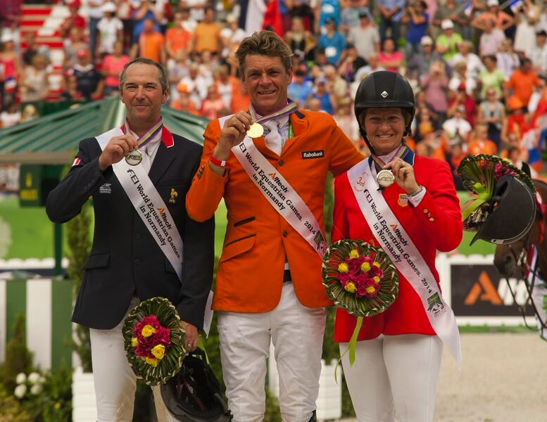 Beezie on the podium with her bronze medal at the 2014 Alltech FEI World Equestrian Games in Normandy with gold medalist Jeroen Dubbeldam (center) of The Netherlands and silver medalist Patrice Delaveau of France. (Photo by Allen MacMillan/MacMillan Photography)