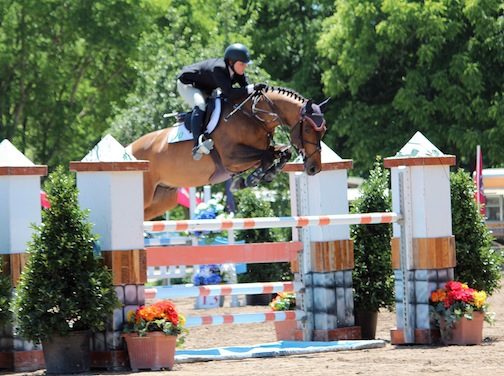 Apipo, owned by Andrew Kocher, jumping the orange liverpool at Brownland Farm with Callie. (Photo by Elaine Schott)