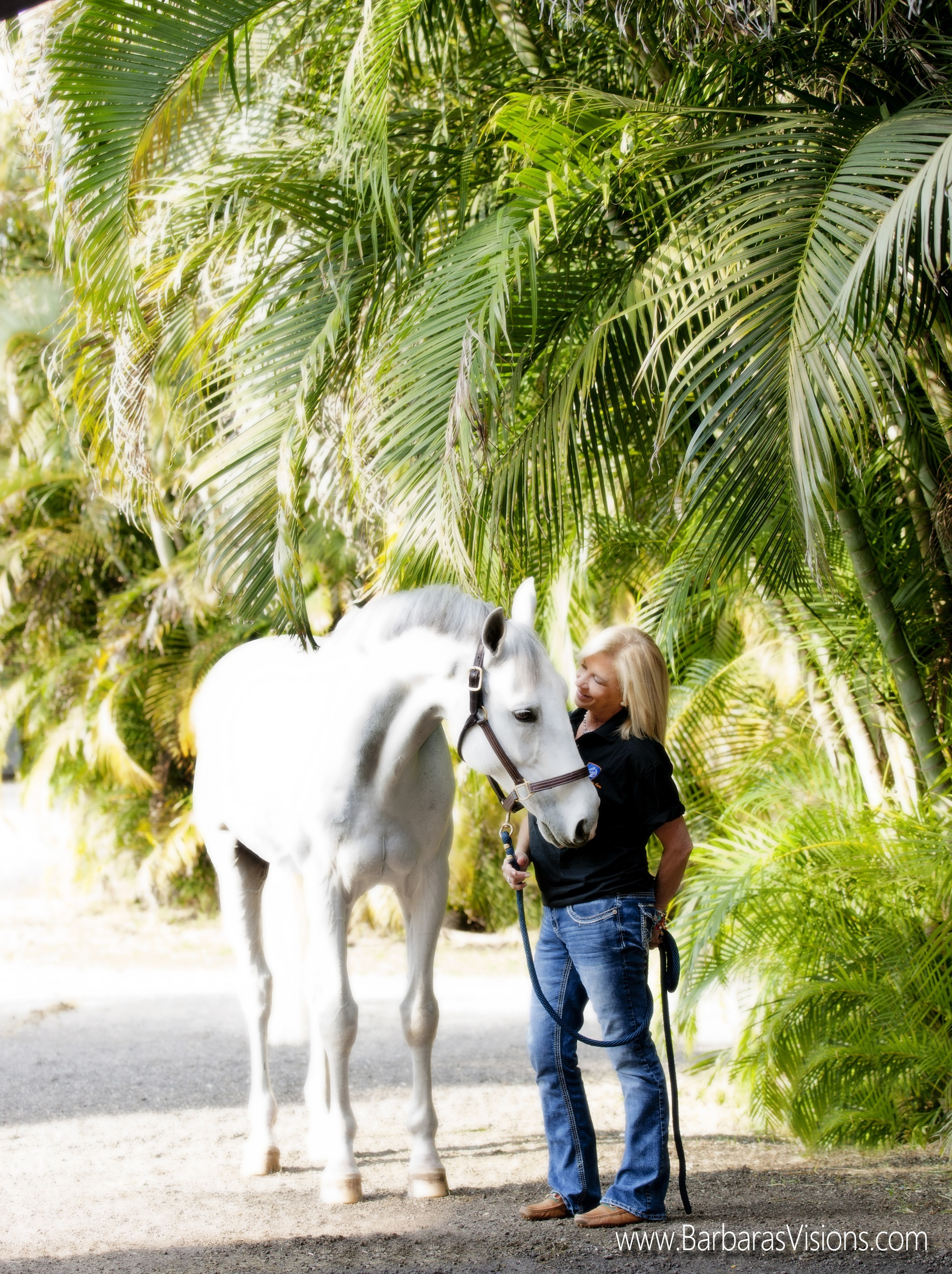 Liliane spends a moment with one of her horses in Florida. (Photo by Barbara Bower, www.barbarasvisions.com)