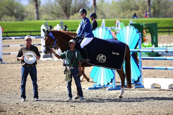 Chenoa on Valentina RC, with her father, Guy McElvain and groom Ulysses Rubio,  winning the HITS Thermal Final $10,000 Junior AO Classic this past winter. (Photo by Sharon McElvain)
