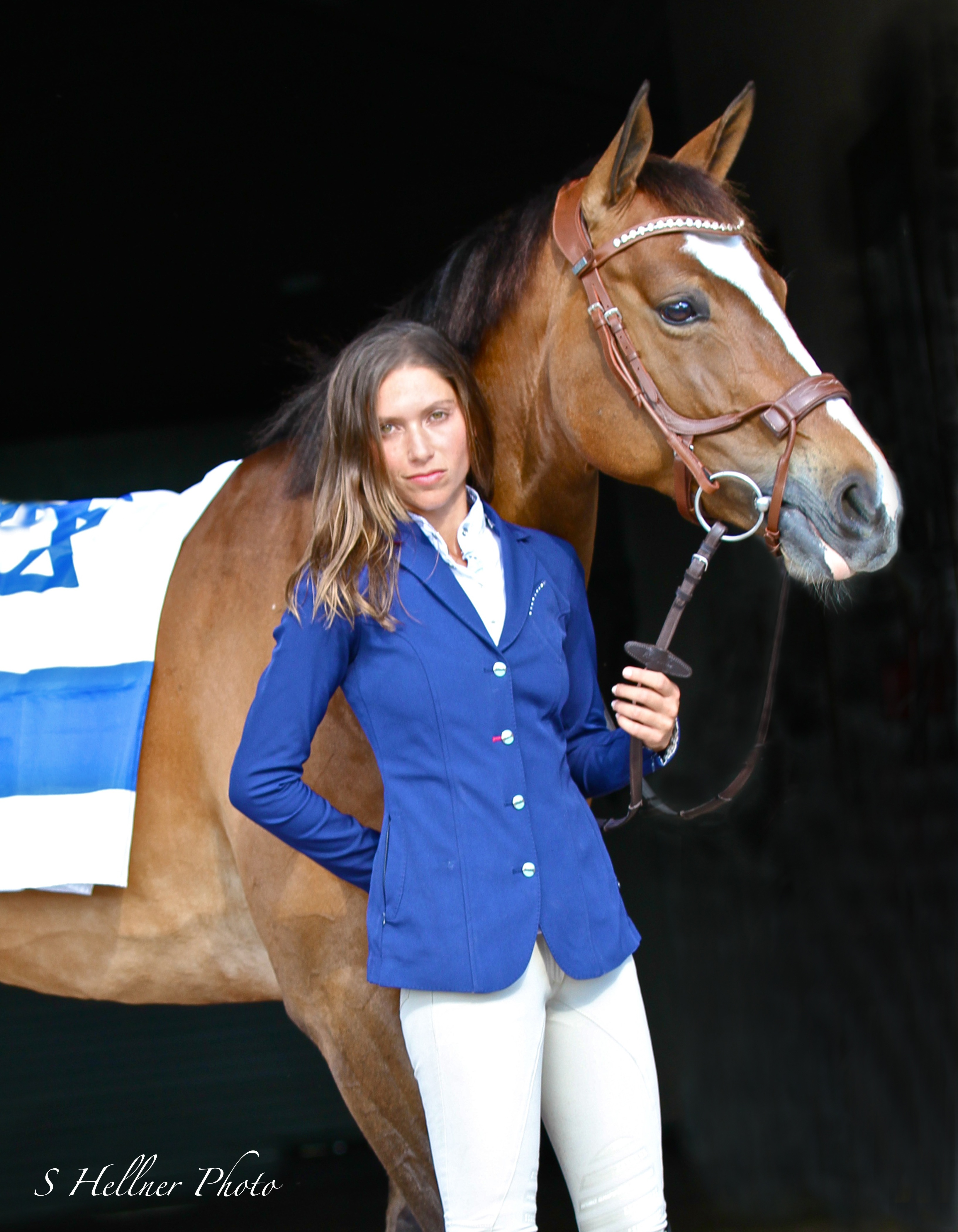 As the National Champion of Israel in Show Jumping, Nataly shows off the Israeli flag. (Photo by S Hellner Photography, Shellner.Photoshelter.com)