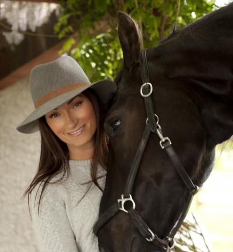 CEO and designer of Asmar Equestrian, Noel Asmar, with her Friesian, Jake