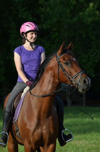 Allana riding Benny in July 2015, sporting a pink helmet — pink for breast cancer awareness!