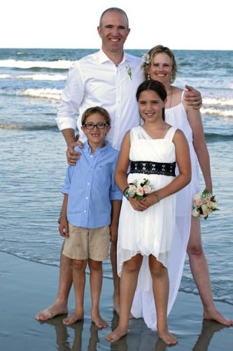 Kristin's wedding! With husband Matt and step-children Ashlyn and Lincoln. Photo courtesy of Kristin Crosland