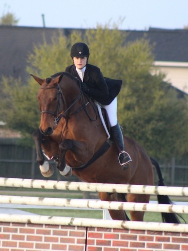 Lizzie riding Bull Run's Rubicon in an equitation class