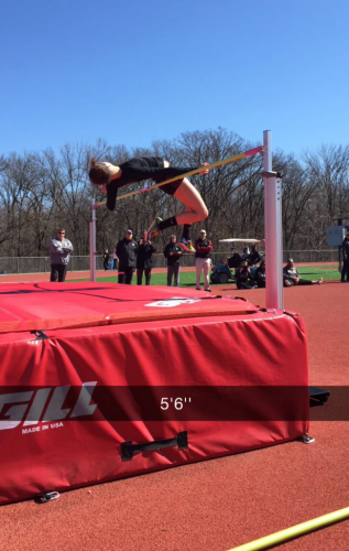 Clearing the bar during the high jump