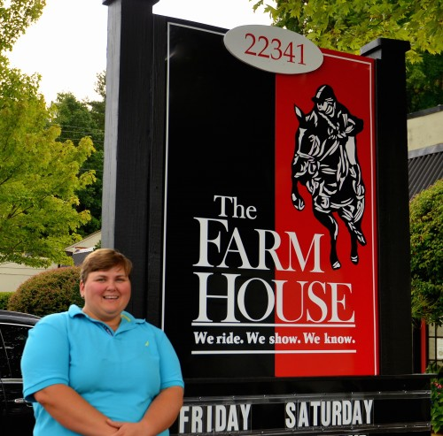 Vicki stands in front of the Farm House sign. Working at the tack store for 25 years has certainly made her part of the family. Photo courtesy of Vicki Wood