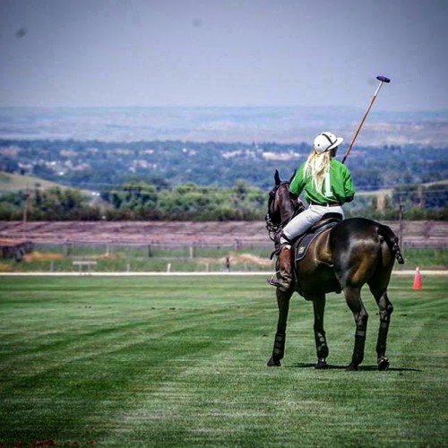 Kerstie playing polo at the Big Horn Polo Club in Sheridan, Wyoming. Photo by Kim Campbell