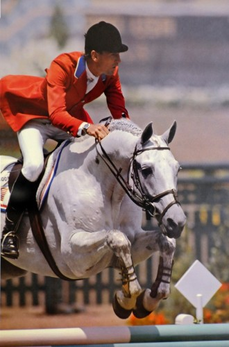 Abdullah and Conrad Homfeld jumping to medals in the 1984 Olympic Games in Los Angeles. Photo by H. Darr Beiser/USA Today