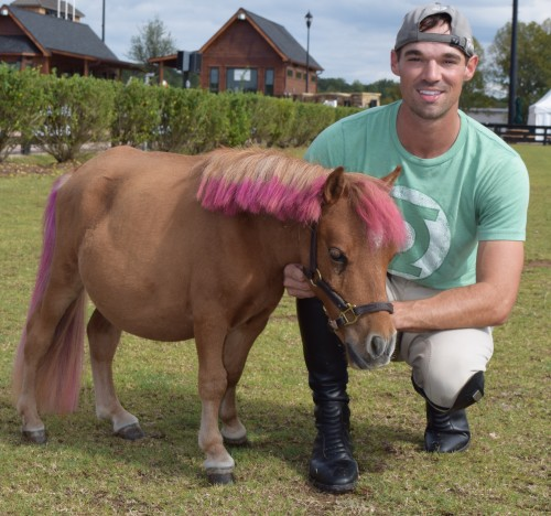 Josh Dolan and his mini Peeps, who sports a cute pink mane and tail.