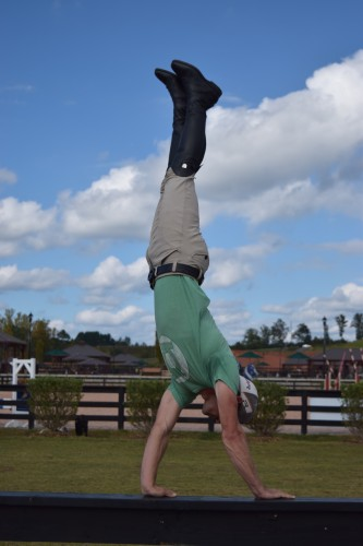Josh Dolan can ride and rescue minis, but he can also do a handstand on a fence!