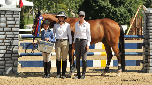 Taje and Drommels captured the Low Children's Championship at WEF. From left to right: Gustavo Murcia, Taje, trainer Maggie Gould and groom Leo. Photo by SportFot