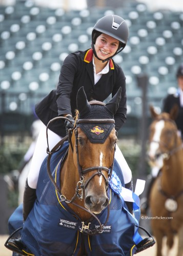 Carly is all smiles after winning the $5000 Low Junior/AO Classic at the Tryon International Equestrian Center. Photo by Sharon Packer, sharonpacker.com