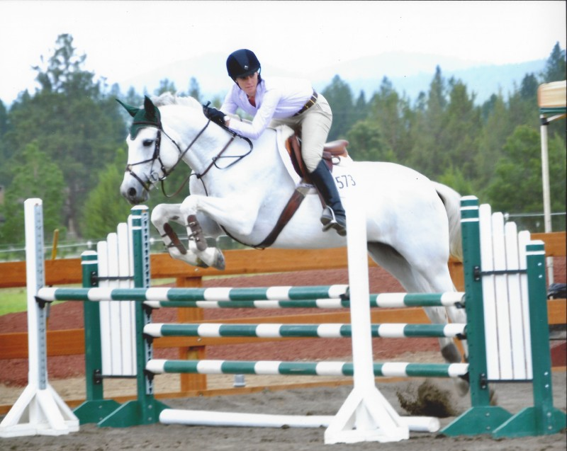 Karen on her Canadian Sport Horse mare Contada M during a winning round in a jumper class in Tumalo, Oregon. Photo by Jade Danek