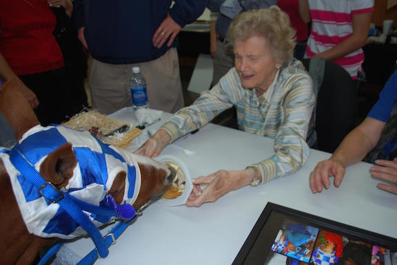 Penny Chenery, the real-life owner of Secretariat, feeds Patrick a treat.