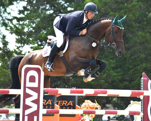 Alpha Omega Farm's Pernod and Gavin clearing the CWD jump in the Grand Prix at HITS Culpeper during the 2015 season.  Photo by Susan McClafferty