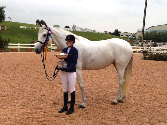 Alden Moylan and sale horse, Viola, winning the Grand Champion Amateur Owner Hunter award at Lexington Spring Premiere in 2013.   Photo by Gavin Moylan