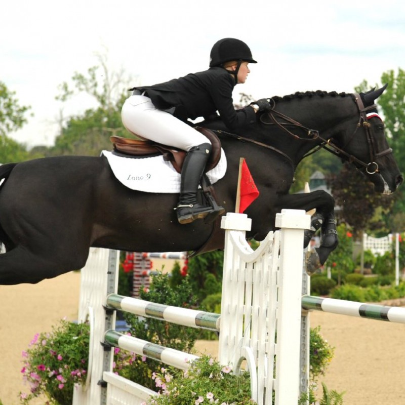 Jennifer on Lord Levisto at the North American Young Rider Championships Photo courtesy of JKG Farms