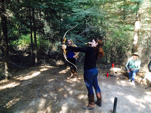 Abby Westmark tries her hand at archery. Photo by Jan Westmark