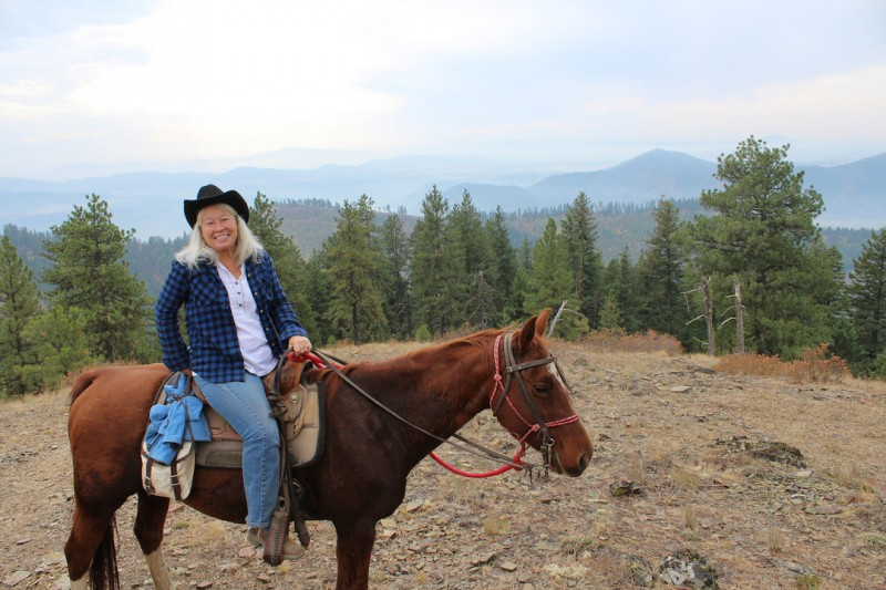Maureen Dorsey enjoys time in the saddle — and a view — at Red Horse Mountain Ranch. Photo by Anne Joubert