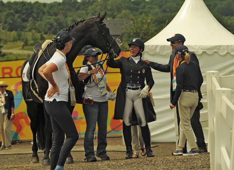 Kim enjoying a moment with her team at the Pan Am Games. Photo by Kim MacMillan/MacMillan Photography