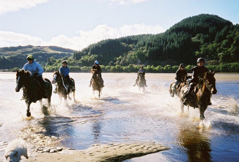 Cathy (second on right) and her fellow travelers gallop along the shore of Loch Fyne, longest of the sea lochs, the name meaning loch or lake of wine or vine and known for its oyster fisheries