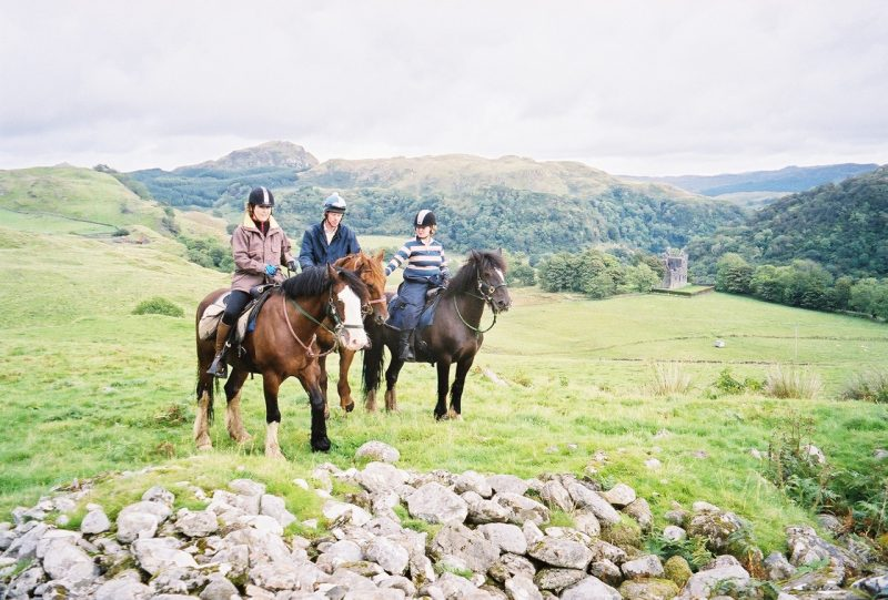 Cathy, left, Peter from Ireland, and Jane from Scotland were privileged to ride across the estate lands of 18th century Stonefield Castle (in background)