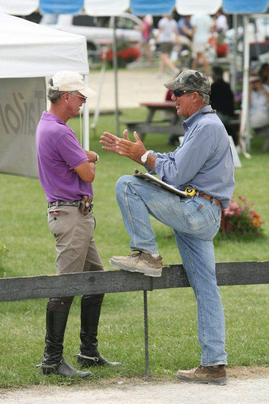Billy (right) speaks with exhibitor Chuck Waters at the Vermont Summer Festival. Photo by David Mullinix Photography