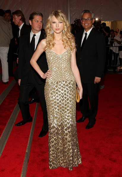 Mark Badgley, right, and James Mischka watch singer Taylor Swift on the red carpet wearing a Badgley Mischka gown. Photo courtesy of Badgley Mischka