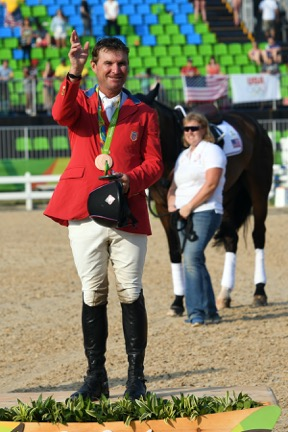 Phillip earning his first individual Olympic medal. Photo by Allen MacMillan/MacMillan Photography